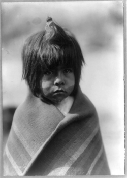 Chemehuevi boy, Arizona. Indian boy, half-length portrait, standing, facing right; wearing blanket. c1907. (c) Edward Sheriff Curtis, 1868-1952, photographer.